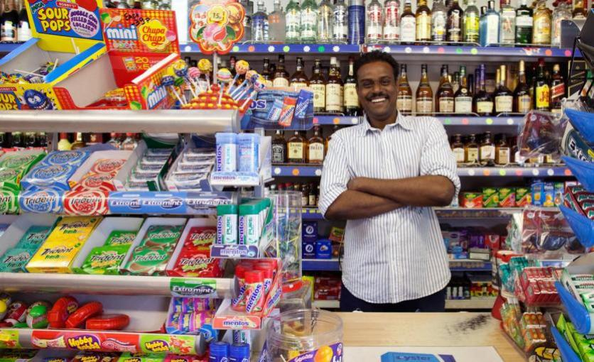 Grocer in his shop